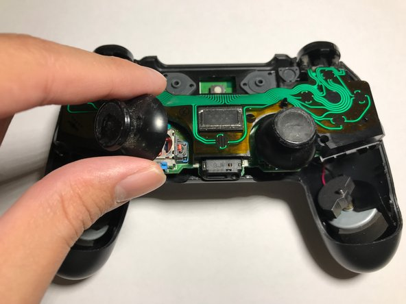Remove the analog sticks and motors.