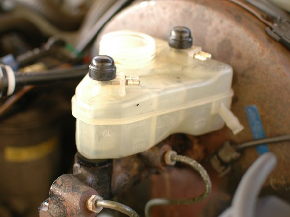 Your brake fluid reservoir is now ready to go, except for the plug connections. Re-install them.