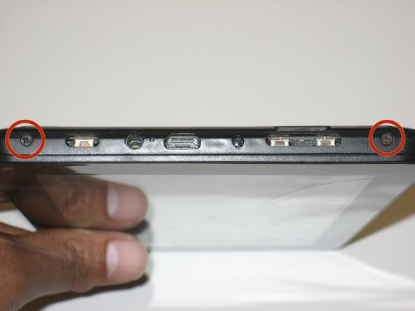 Remove the two 2.5mm Phillips head screws before attempting to remove the screen from the device.