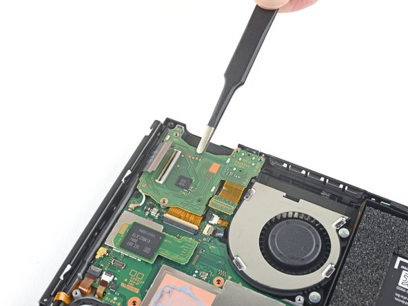 Use a pair of tweezers or your fingers to remove the headphone jack and game card reader board.