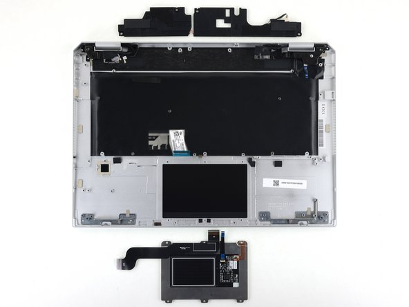 The upper speaker assembly is accessible after motherboard removal.