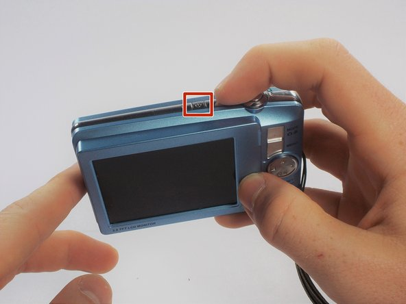 Make sure the camera is powered off by pressing and holding the small, square button embedded in the top rim of the camera.