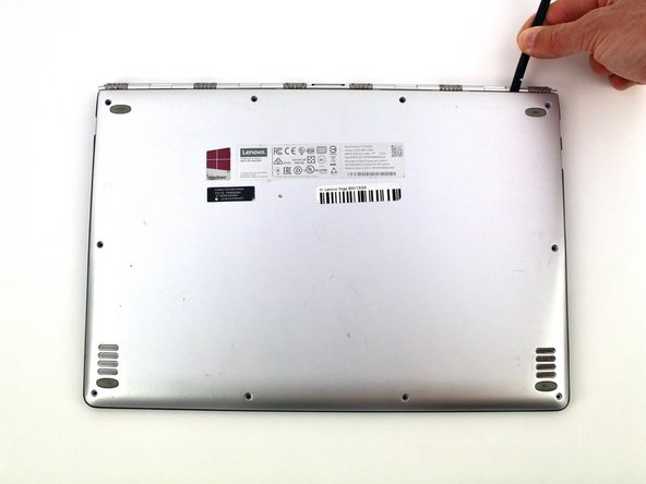 Use a spudger to pry open the back case at the hinges of the laptop.