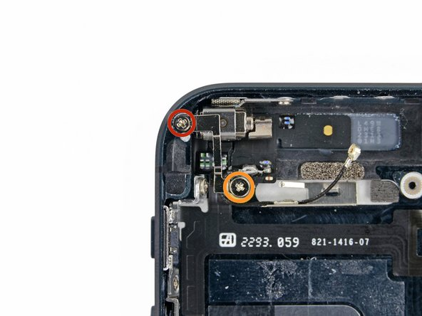 Remove three screws securing the vibrator and vibrator bracket to the rear case: