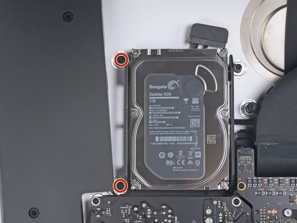 Use a T8 driver to remove the two 7.3 mm screws securing the left hard drive bracket to the rear case.