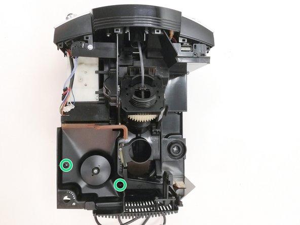 Entferne die 2 Schrauben auf dem Bohnenbehälter der Kaffeemaschine mit dem Schraubendreher Torx T10.
