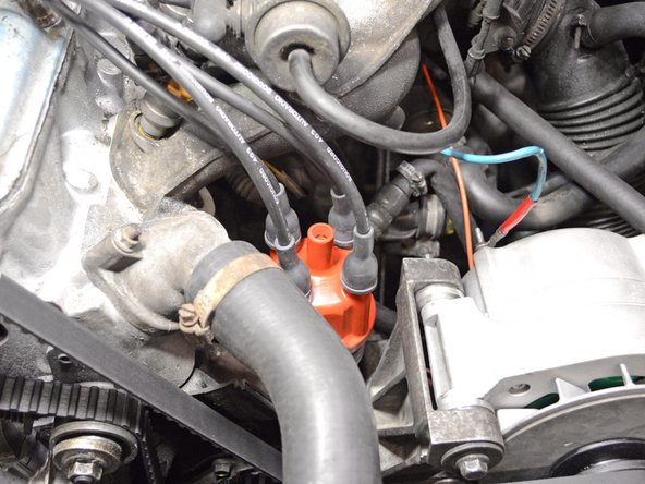 Connect the spark plug wires to the new distributor cap one at a time. Mixing up the order will result in the engine not firing properly or at all.