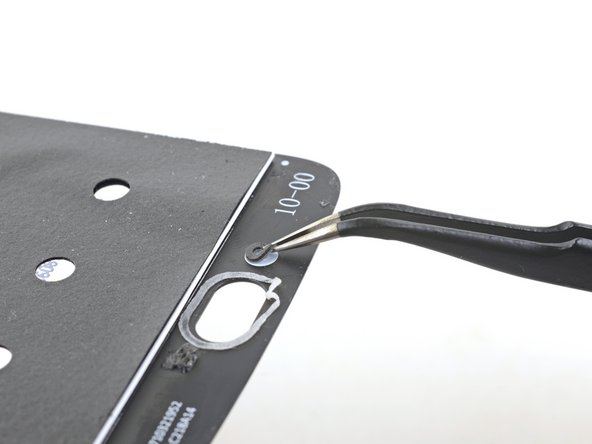 If your replacement part did not come with a lower microphone gasket, use tweezers to carefully peel it from your old screen and transfer it to your replacement part.