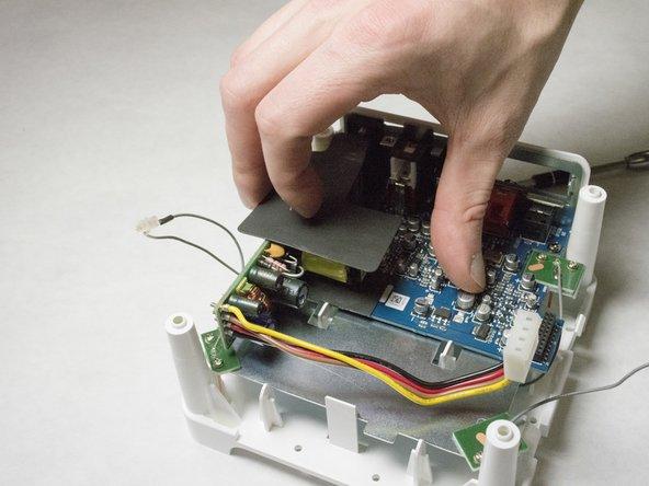 Remove foam protective insulator from the bottom board.