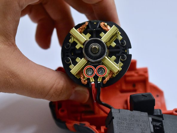 Remove the motor from the case and unscrew the two 8mm screws, using the T3 Torx Screwdriver, on the back of the motor.