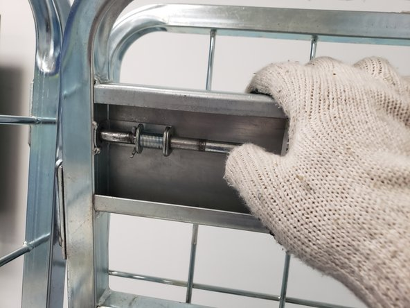 Pull the circular long latch towards you on the top metal holder bracket.