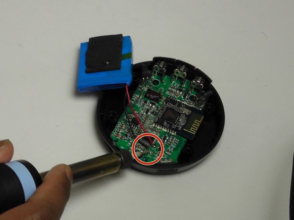 Use a solder gun to remove the battery attachments from the motherboard.