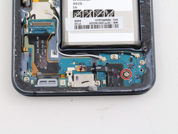 Remove one 3.5 mm screw using a Phillips #00 screwdriver.