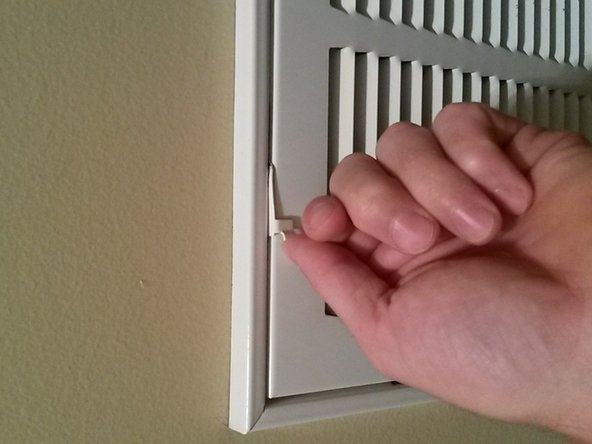 Pull out both latches so that they are perpendicular to the wall