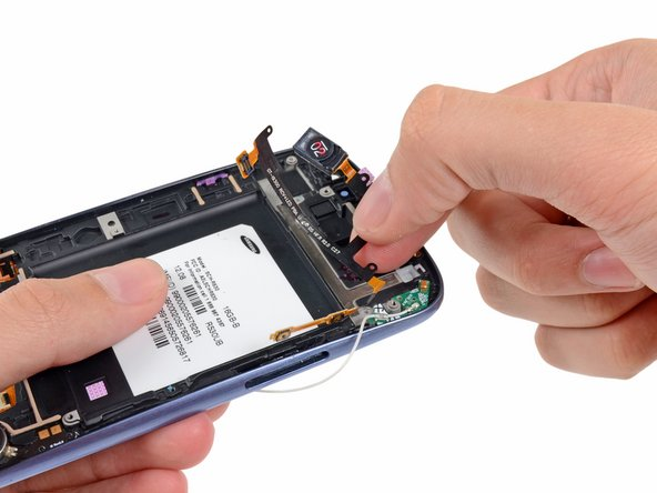 Grasp and remove the earpiece/buttons/ambient light sensor ribbon cable out of the phone.