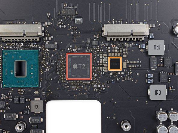 Last but far from least, hovering near the SSD slots, we have two custom Apple chips: