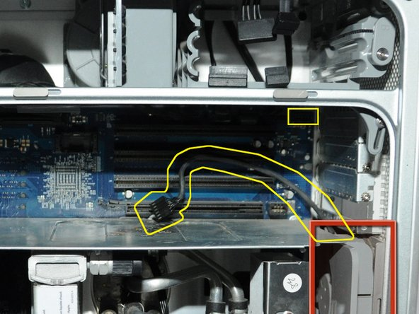 Unplug the fan's power cable from the upper rightmost corner of the motherboard (connection J45). If there is a video card in place, carefully pull the cable plug down between the back edge of the video card and the motherboard. Note,  the photo shows the unplugged cable and the area it plugs into outlined in yellow. No video card is shown in this photo.
