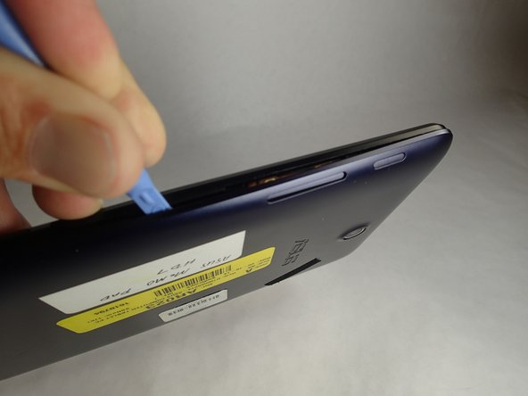 Carefully remove the back panel by using a plastic opening tool to remove the panel off the device.