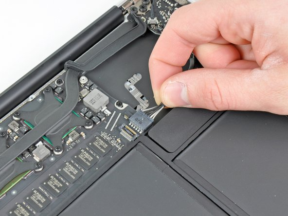 Disconnect the I/O board by pulling the power cable away from its socket on the logic board.