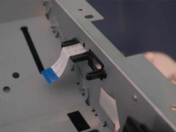 The cable clip for the laser assembly cable can be removed from the chassis.
