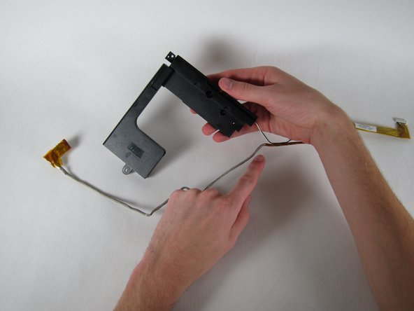 Cut the tape that attaches the USB cable to the left speaker cable.