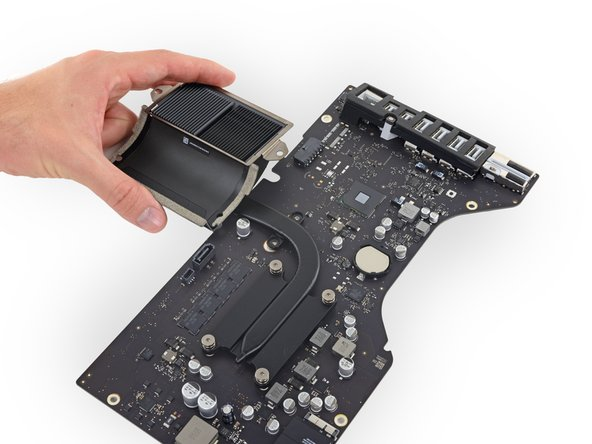 Lift and remove the heat sink assembly from the logic board.