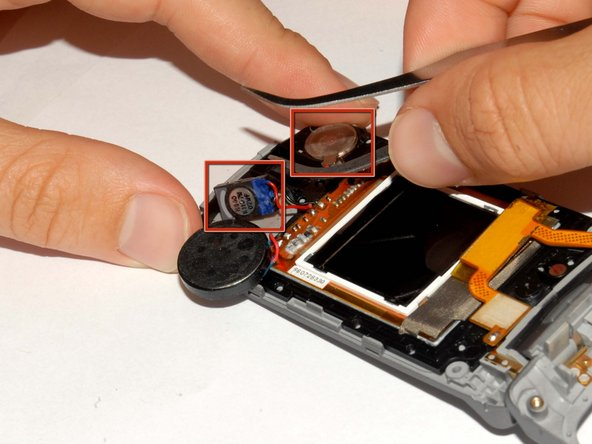 Remove the earpiece and gyroscope by lifting them out of the phone casing using tweezers.