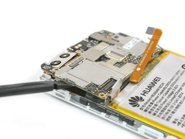 Now you can lift out the motherboard to access the earpiece speaker.