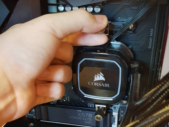 Remove the screws that are connecting the CPU cooler and wires to the motherboard.