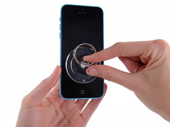 Press a suction cup onto the screen, just above the home button.