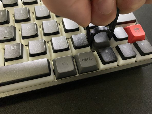 Align the keycap puller with the keycap.