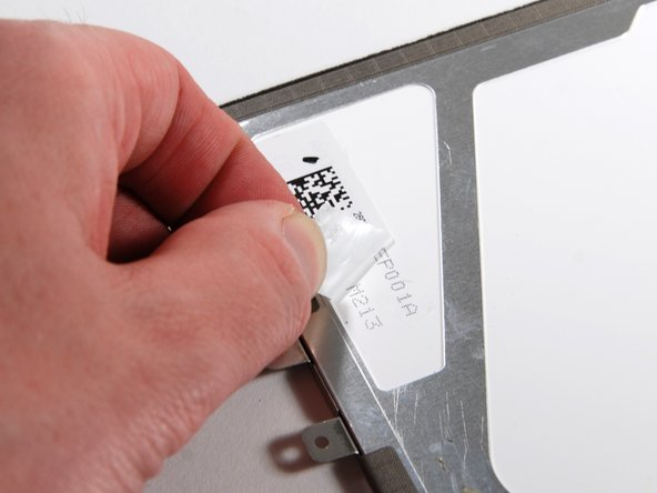 Peel back the sticker, and more part numbers can be seen near the bottom of the LCD.