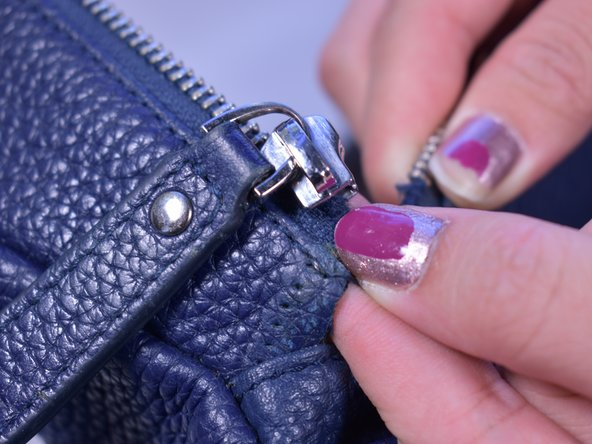 Place the slider back on the zipper.