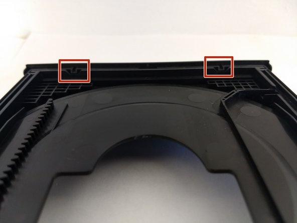 Remove the front cover of the tray.
