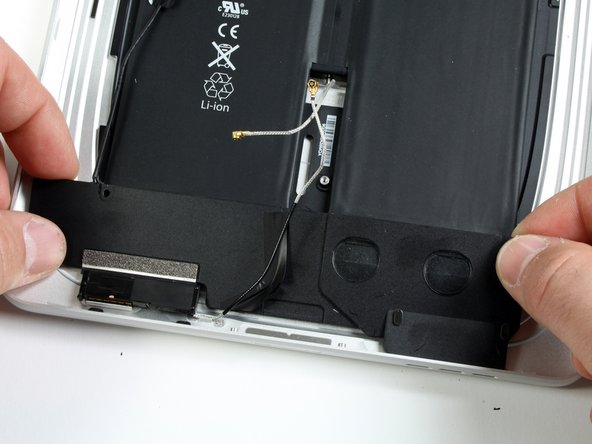 Lift the speaker assembly and push it forward until the ports clear the bottom side of the rear panel assembly.