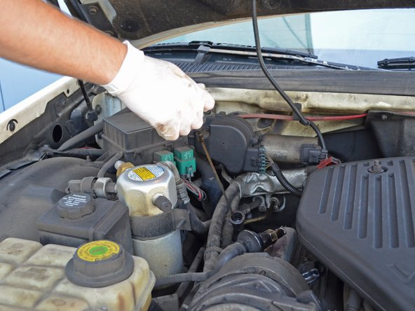 Remove the dipstick from your engine.