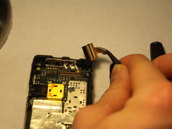 Put the logic board back into place and reattach cable number 1.