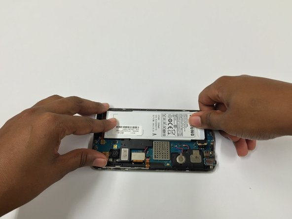 Insert the battery into its position, and reconnect its tab onto the motherboard.