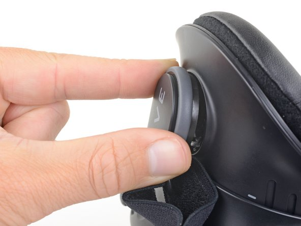 Remove the left head strap mount from the Vive.