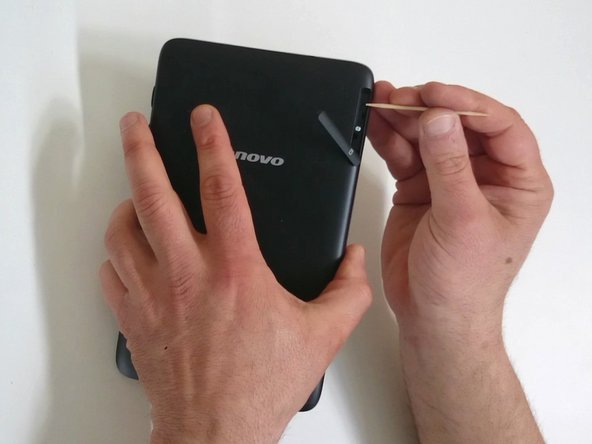 1. Switch of the tablet. If the device freezes, you can use a reset hole under the memory card reader cover.