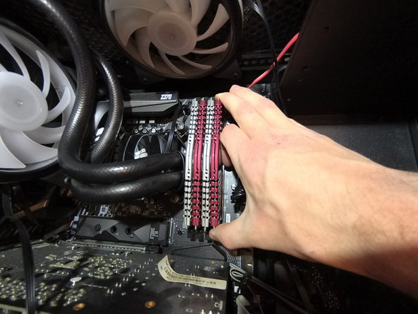Firmly grab one RAM stick on each side of the stick and pull straight up out of the slot.