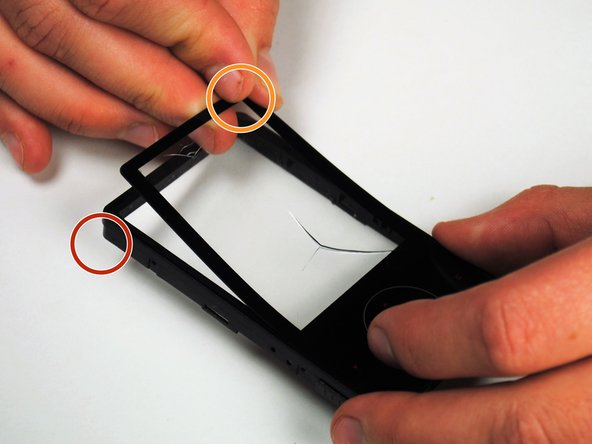 Carefully pry apart the screen from the frame of the device.