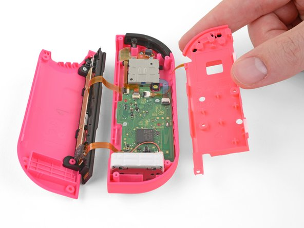 Carefully flip the midframe over, away from the motherboard, as if you were turning the page of a book.