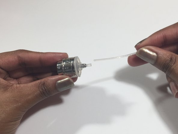 Using your hands, insert the tube back into the opening.