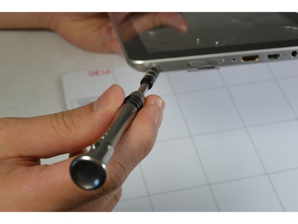 Remove the two screws from the end of the device where the ports are located using a Phillips #1 screwdriver.