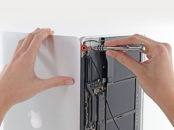 While holding the Air steady, remove the remaining 5.6 mm T8 Torx screw from the left display bracket.