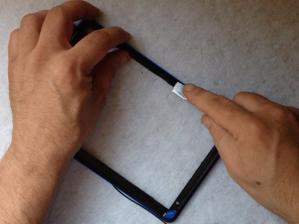 Before installing the new touch screen, clean the frame and put double side adhesive tape.
