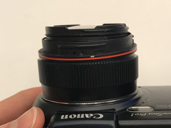 Remove plastic ring with the red strip around it.