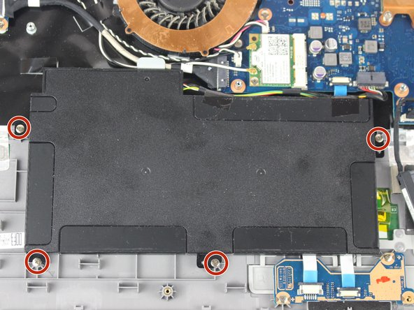 Use the screwdriver to remove the four 3.5mm long screws holding the battery in place. Then carefully pull the battery's connector cable out to remove the battery.
