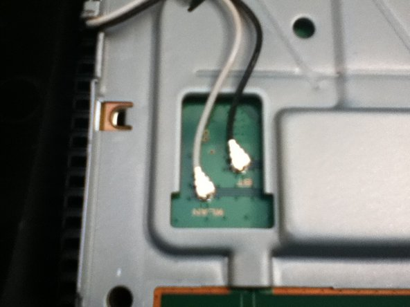 Remove the wireless aerial from the motherboard so that you can replace with a toggle antenna.